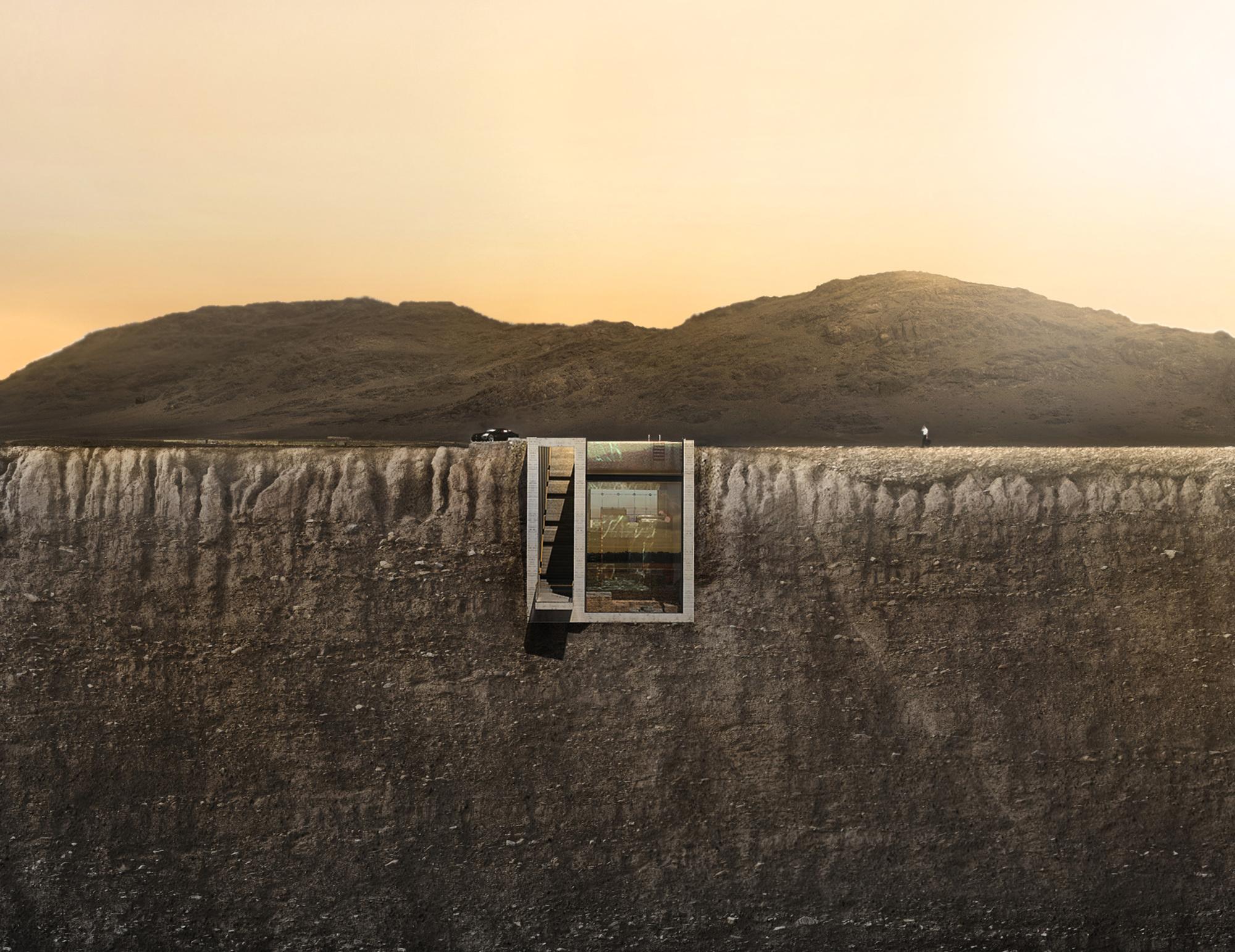 Vue aérienne de face de la casa brutale sous la lumière orangée du crépuscule grec.